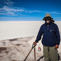 Workers work on salt  in the world's largest salt flat, Salar de Uyuni in Bolivia. Photographer: Bernardo De Niz