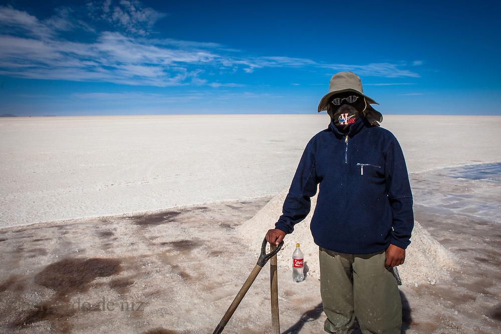 Workers work on salt  in the world's largest salt flat, Salar de Uyuni in Bolivia. Photographer: Bernardo De Niz
