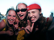 Three happy girls at rock gig show off their devil horns, Big Day Out Festival, Perth, Australia 1990s.