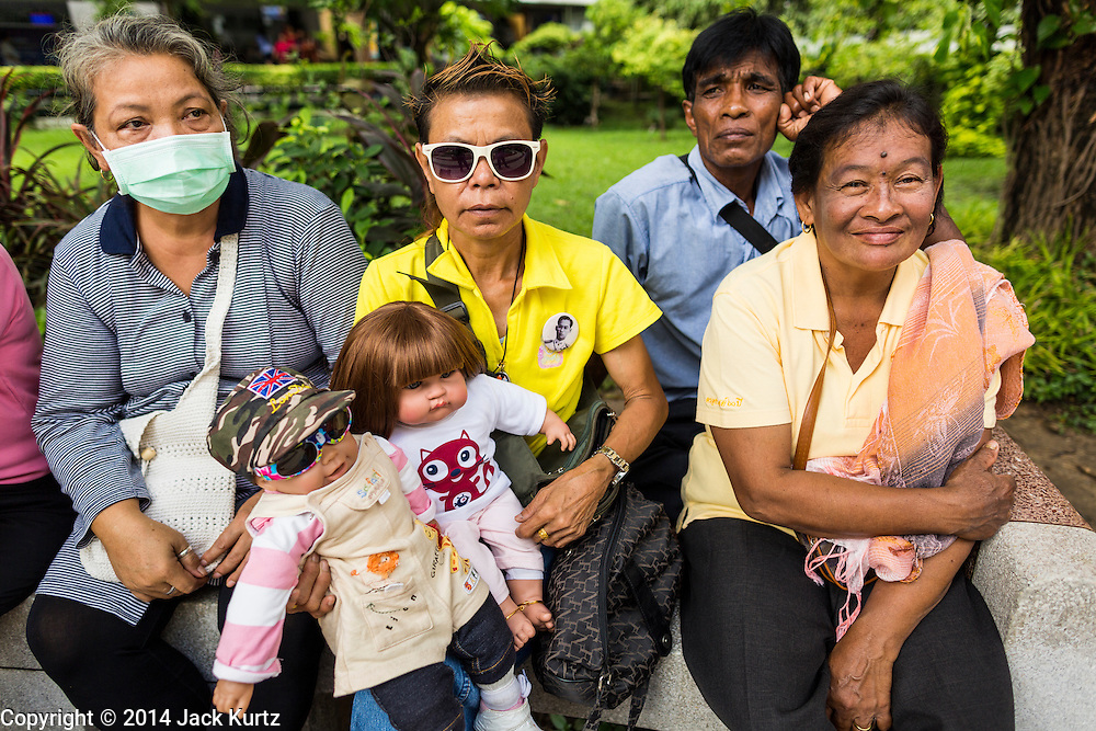 09 OCTOBER 2014 - BANGKOK, THAILAND: Women wait to get into Siriraj Hospital to pray for Bhumibol Adulyadej, the King of Thailand. People wear yellow when they pray for the King because it's the King's color. The King has been hospitalized at Siriraj Hospital since Oct. 4 and underwent emergency gall bladder removal surgery Oct. 5. The King is also known as Rama IX, because he is the ninth monarch of the Chakri Dynasty. He has reigned since June 9, 1946 and is the world's longest-serving current head of state and the longest-reigning monarch in Thai history, serving for more than 68 years. He is revered by the Thai people and anytime he goes into the hospital thousands of people come to the hospital to sign get well cards.   PHOTO BY JACK KURTZ