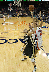 Virginia's Brenna McGuire (10) shoots over Wake Forest's Corinne Groves (33).  The Cavaliers defeated the Demon Deacon 77-71 on January 11, 2007 for their first ACC win in the John Paul Jones Arena in Charlottesville, VA.<br />