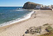 Sandy beach at Isleta de Moro village, Cabo de Gata natural park, Nijar, Almeria, Spain
