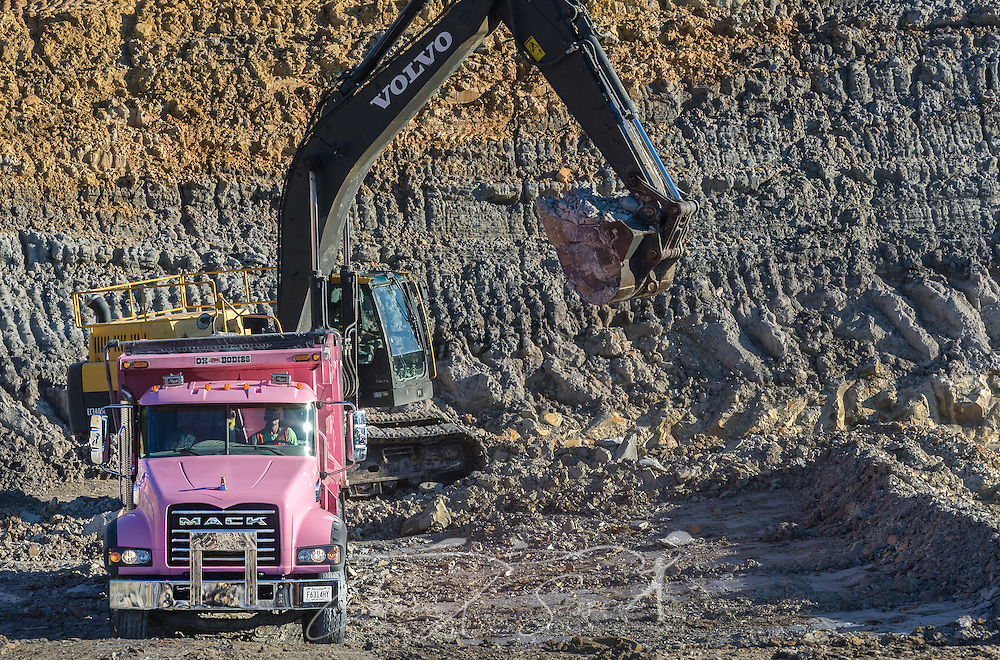 An employee with KR Trucking loads kaolin clay into a 2015 Mack Granite dump truck, Sept. 20, 2016, in Huntingdon, Tennessee. The company, which mines both kaolin and ball clay, uses primarily Mack Granites in its fleet. (Photo by Carmen K. Sisson/Cloudybright)
