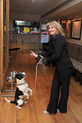 JACKIE PRESCOTT and dog Tippy Toes at The Dog's Trust Awards announcement held at George, 87-88 Mount Street, London on 27th March 2012.
