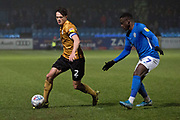 Crewe Alexandra defender Perry Ng tackled by  Macclesfield Town forward Arthur Gnahoua  during the EFL Sky Bet League 2 match between Macclesfield Town and Crewe Alexandra at Moss Rose, Macclesfield, United Kingdom on 21 January 2020.