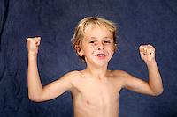 Young strong boy flexing his muscles. Caucasian kid, human body.