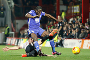 Brentford defender John Egan (14) commits a foul on Birmingham City Forward Clayton Donaldson (9) during the EFL Sky Bet Championship match between Brentford and Birmingham City at Griffin Park, London, England on 26 November 2016. Photo by Andy Walter.