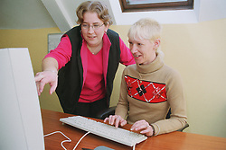 IT trainer teaching client basic computer skills,