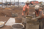 Women working at palm oil processing plant outside Ashaiman, one of Ghana's largest slums. The plant is set a few meters away from a large garbage dump.