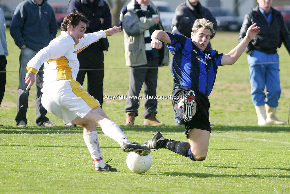 Miramar Rangers Michael Leonards flys into the challenge as Eastern Suburbs Hoani Edwards controls the ball in their Bluebird Chatham Cup Semi Final match played at Madills Farm, Auckland, Saturday 14th August, 2004. Ben Campbell/Photosport