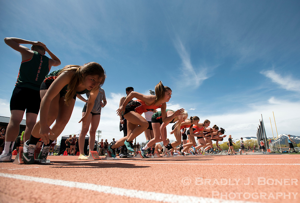 Runners break out of the starting gate for the 100-meter dash during Jackson Hole High School's home track meet Saturday at William T. McIntosh Stadium.