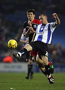 Lee Bullen of Sheffield Wednesday battles with Grzegorz Rasiak of Southampton