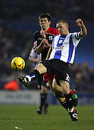 Lee Bullen of Sheffield Wednesday battles with Grzegorz Rasiak of Southampton