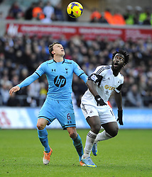 Swansea City's Wilfried Bony battles for the high ball with Tottenham Hotspur's Vlad Chiriches - Photo mandatory by-line: Joe Meredith/JMP - Tel: Mobile: 07966 386802 19/01/2014 - SPORT - FOOTBALL - Liberty Stadium - Swansea - Swansea City v Tottenham Hotspur - Barclays Premier League