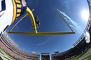 Fireworks fly over Qualcomm Stadium in this wide angle, general view photo of the stadium and end zone goal post taken from field level during pregame before the San Diego Chargers NFL week 15 regular season football game against the Denver Broncos on Sunday, Dec. 14, 2014 in San Diego. The Broncos won the game 22-10. ©Paul Anthony Spinelli