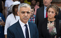 © Licensed to London News Pictures. 18/06/2017. London, UK. London Mayor Sadiq Khan stands with his wife Saadiya Khan after attending a church service near site of the burnt out Grenfell tower block . The blaze engulfed the 27-storey building killing dozens - with 34 people still in hospital, many of whom are in critical condition. The fire brigade say that they don't expect to find anyone else alive. Photo credit: Peter Macdiarmid/LNP