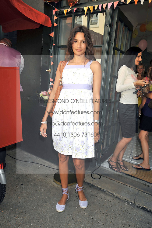 ASTRID MUNOZ at the 10th anniversary party of the store Caramel, Ledbury Road, London W11.  The party was held in association with the Naked Heart Foundation - a charity set up by model Natalia Vodianova.