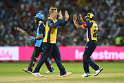 Simon Harmer and Ravi Bopara of Essex Eagles celebrate the wicket of Moeen Ali during the Vitality T20 Finals Day 2019 match between Worcestershire County Cricket Club and Essex County Cricket Club at Edgbaston, Birmingham, United Kingdom on 21 September 2019.