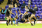 Matt Whitley tackles Ryan Bailey during the Super League match between Warrington Wolves and Widnes Vikings at the Haliwell Jones Stadium, Warrington, United Kingdom on 9 September 2016. Photo by Craig Galloway.