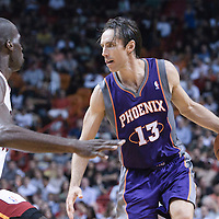 17 November 2010: `Phoenix Suns' point guard #13 Steve Nash drives past Miami Heat's center #50 Joel Anthony during the Miami Heat 123-96 victory over the Phoenix Suns at the AmericanAirlines Arena, Miami, Florida, USA.