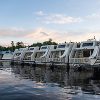A row of houseboats awaits the summer crowds.