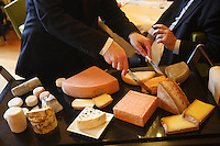 choosing cheeses during lunch at the Paul Bocuse Institute, Lyon, France..photograph by Owen Franken