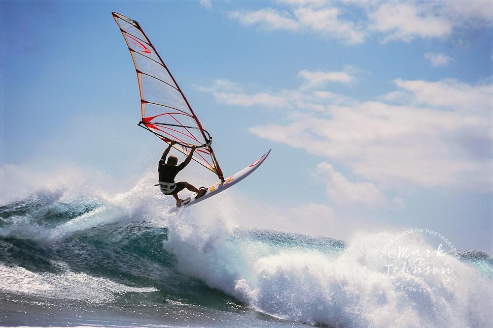 Kauai, Hawaii, USA --- Windsurfing on Breaking Wave