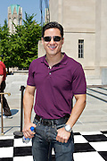 Actor and television personality Mario Lopez poses on the checkered carpet prior to the IPL 500 Festival Parade on Saturday morning.
