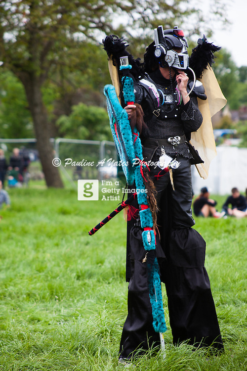 A Stilt Walker performing at Strawberry Fair, Midsummer Common, Cambridge. Dressed as a Transformer