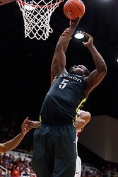 Feb 19, 2012; Stanford CA, USA; Oregon Ducks forward Olu Ashaolu (5) shoots against the Stanford Cardinal during the second half at Maples Pavilion. Oregon defeated Stanford 68-64. Mandatory Credit: Jason O. Watson-US PRESSWIRE
