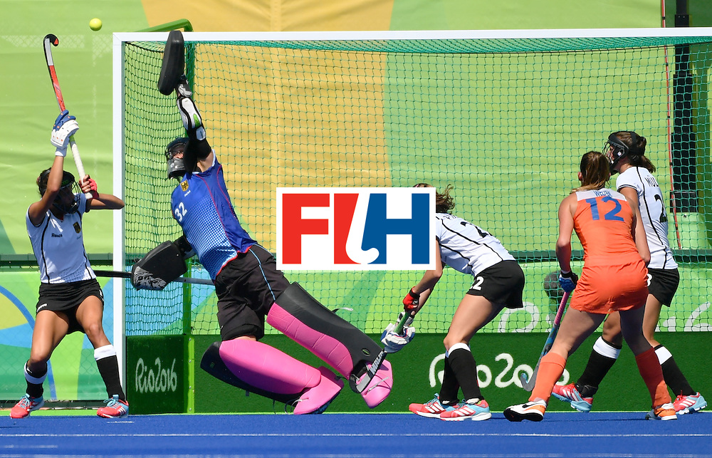 Germany's goalkeeper Kristina Reynolds (2nd L) stops a ball during the women's semifinal field hockey Netherlands vs Germany match of the Rio 2016 Olympics Games at the Olympic Hockey Centre in Rio de Janeiro on August 17, 2016. / AFP / Pascal GUYOT        (Photo credit should read PASCAL GUYOT/AFP/Getty Images)