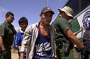 U.S. Border Patrol agents prepare for deportation a group of undocumented migrants from Mexico near Sells, Arizona on the Tohono O'odham Nation.  The area has the highest death rate of illegal border crossers in the nation.