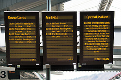 © Licensed to London News Pictures. 05/04/2015. Swansea, UK. Signs notify travellers of disruption to rail services as they board the Swansea to Paddington First Great Western service at Swansea on Easter Sunday.   The journey time is expected to take 1 hour 20 minutes longer than normal due to the major engineering works between Hayes & Harlington and Didcot Parkway, and at Reading.   The service will be diverted via Oxford, and will not stop at its usual stop Reading.  Photo credit : Richard Isaac/LNP