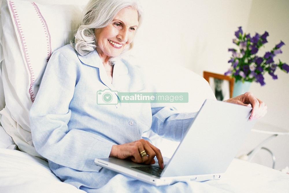 Dec. 14, 2012 - Woman using laptop computer (Credit Image: © Image Source/ZUMAPRESS.com)