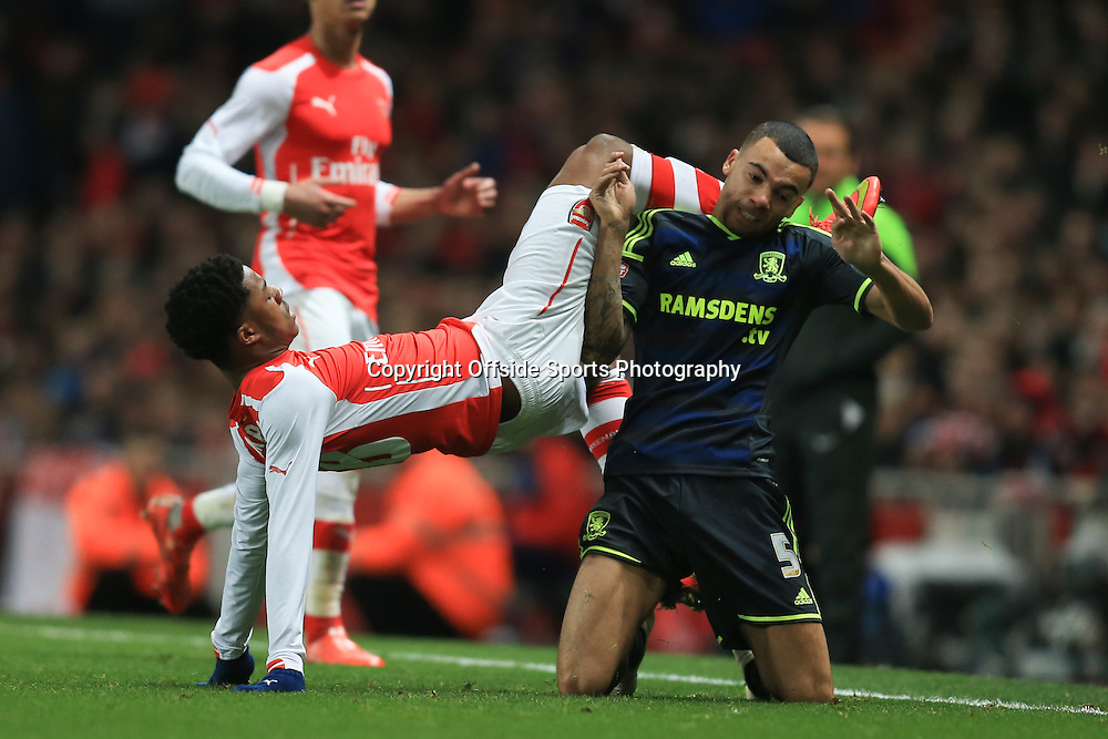 15 February 2015 - The FA Cup Fifth Round - Arsenal v Middlesbrough - Chuba Akpom of Arsenal tangles with Ryan Fredericks of Middlesbrough  - Photo: Marc Atkins / Offside.