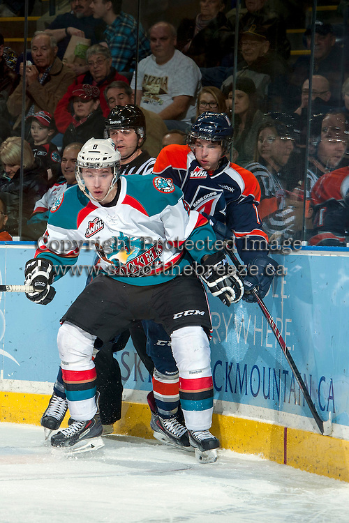 KELOWNA, CANADA -FEBRUARY 1: Colten Martin #8 of the Kelowna Rockets checks a player of the Kamloops Blazers into the boards on February 1, 2014 at Prospera Place in Kelowna, British Columbia, Canada.   (Photo by Marissa Baecker/Getty Images)  *** Local Caption *** Colten Martin; Cole Martin;