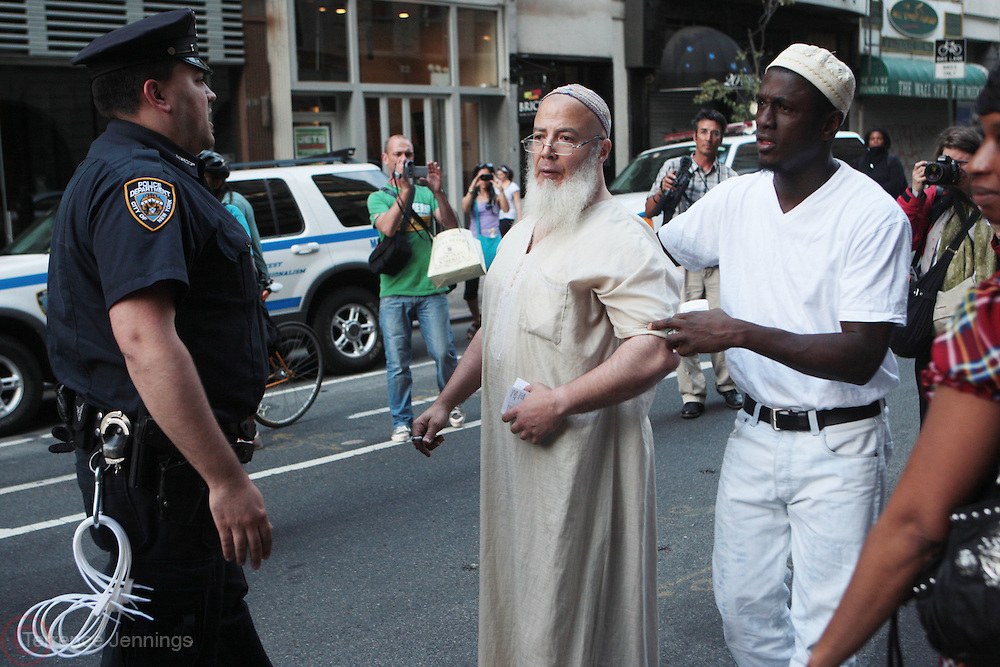 11 September 2010- New York, NY- Atmosphere at the protests of the construction of the controversial Cordoba House, the Muslim Cultural Center to be constructed by The Park51 Group, demonstrate in lower Manhattan blocks from the World Trade Center. Many  surviving family members of victims of the 9/11 Attacks were in attendance in this hotly debated and contested area in lower Manhattan on September 11, 2010 in New York City. Photo Credit: Terrence Jennings/Sipa Press