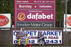A man sells scarves outside the ground during the Premier League match at Turf Moor, Burnley.