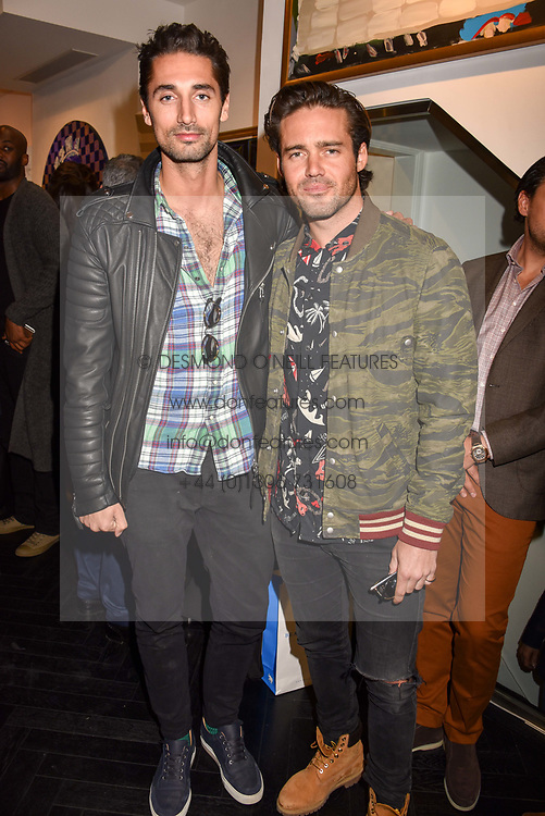 Left to right, Hugo Taylor and Spencer Matthews at a private view of work by Bradley Theodore entitled 'The Second Coming' at the Maddox Gallery, 9 Maddox Street, London England. 19 April 2017.