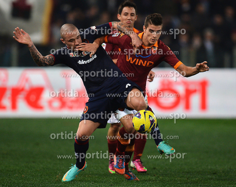 01.02.2013, Olympiastadion, Rom, ITA, Serie A, AS Rom vs Cagliari Calcio, 23. Runde, im Bild David Nainggolan Cagliari, Erik Lamela Roma // during the Italian Serie A 23th round match between AS Roma and Cagliari Calcio at the Olympic Stadium, Rome, Italy on 2013/02/01. EXPA Pictures © 2013, PhotoCredit: EXPA/ Insidefoto/ Andrea Staccioli..***** ATTENTION - for AUT, SLO, CRO, SRB, BIH and SWE only *****