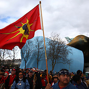 People gather during a ceremony at the Seattle Center on Sunday February 26, 2012 in Seattle. A 33-foot tall totem pole was erected Sunday in honor of slain Native American woodcarver John T. Williams. Williams was shot and killed by a Seattle Police officer in 2010. The shooting was later ruled unjustified.  (Joshua Trujillo, seattlepi.com)