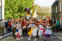 Dakadoum Samba Band and dancers take part in the Penryn Festival in Cornwall.