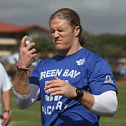 Green Bay Packer linebacker and former USC Trojan, Clay Mathews, sprays sunscreen on his face prior to NFC Pro Bowl practice.  Photo by Barry Markowitz, 1/26/12