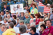 "May 29 - TEMPE, AZ: People opposed to President Barrack Obama and Speaker Nancy Pelosi at an anti-immigration rally in Tempe, AZ. About 3,000 people attended a ""Buy Cott Arizona"" rally at Tempe Diablo Stadium in Tempe, AZ Saturday night. The rally was organized by members of the Arizona Tea Party movement to show support for Arizona law SB1070. The ""Buy Cott"" is a reaction to the economic boycott planned by opponents of SB1070. SB1070 makes it an Arizona state crime to be in the US illegally and requires that immigrants carry papers with them at all times and present to law enforcement when asked to. Critics of the law say it will lead to racial profiling, harassment of Hispanics and usurps the federal role in immigration enforcement. Supporters of the law say it merely brings Arizona law into line with existing federal laws.   Photo by Jack Kurtz"