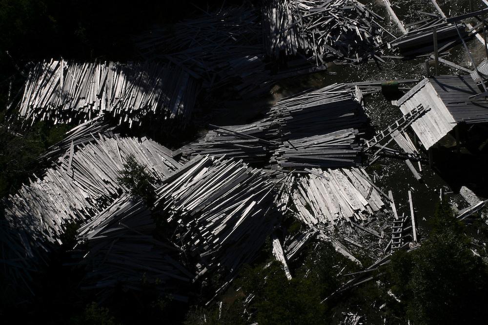 Remnants of a lumber mill which burnt six years earlier in a forest fire near Puerto Montt, Chile, Feb. 12, 2004. Daniel Beltra/Greenpeace.