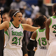 Kayla McBride, Notre Dame, celebrates victory with team mates after the Connecticut V Notre Dame Final match won by Notre Dame during the Big East Conference, 2013 Women's Basketball Championships at the XL Center, Hartford, Connecticut, USA. 11th March. Photo Tim Clayton