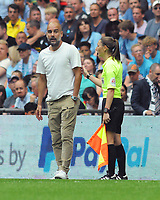 Football - 2019 FA Community Shield - Liverpool vs. Manchester City<br /> <br /> Lines Woman,Sian Massey - Ellis helps Man City Manager Pep Guardiola to calm down, by putting her hand on him at Wembley Stadium.<br /> <br /> COLORSPORT/ANDREW COWIE