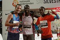 Eric Kiptanui winner (c), Amos Kirui, 2nd (r) and Toni Abadia, 3rd, celebrate after the San Silvestre Vallecana 2017. December 31,2017. (ALTERPHOTOS/Acero)