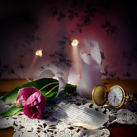 A Murder Is Announced - table top still life of bullet holes in old wallpaper, a pocket watch, newspaper clipping and flowers in a vase, knocked over.