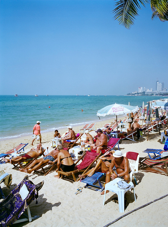 German tourists deepening their bronzed tans on Pattaya Beach.